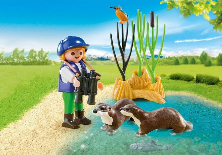Young Explorer with Otters