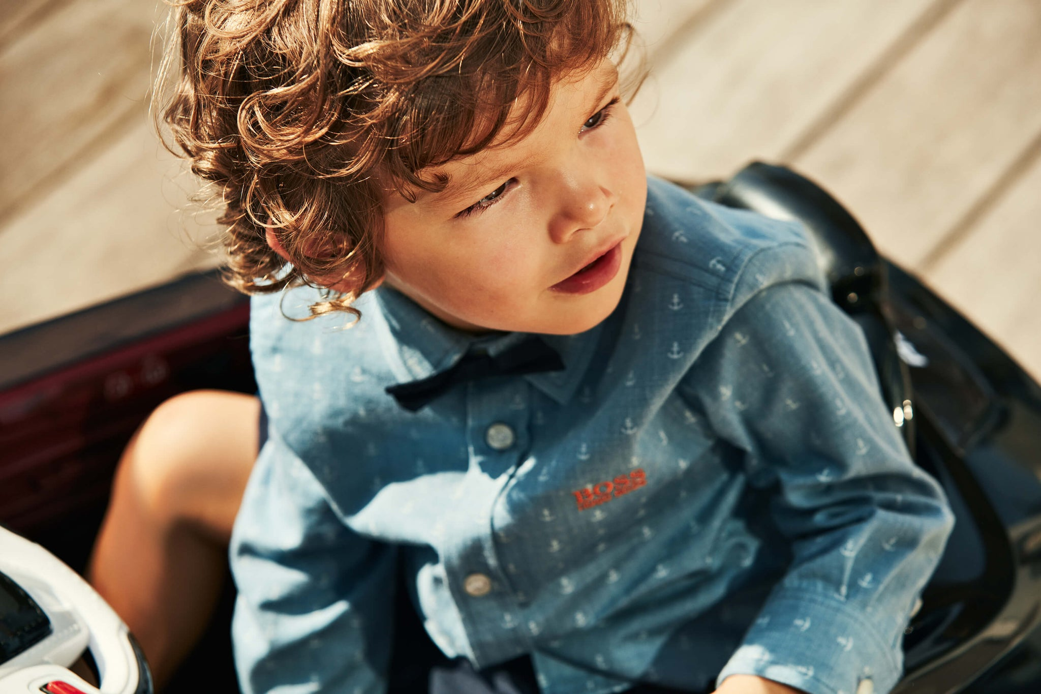 this classic hugo boss look for kids features a nautical themed long sleeve dress shirt complete with fashionable bowtie