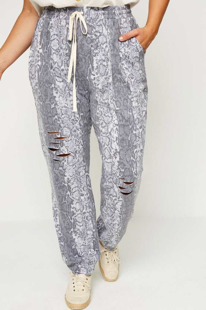 (PLUS) Distressed Snake Joggers - Adorn Boutique in Mitchell