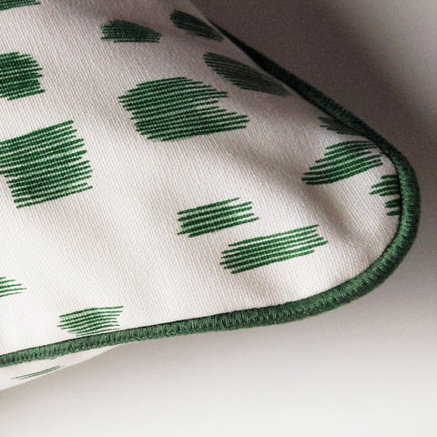 Brunschwig & Fils Les Touches Green pillow cover with Samuel & Sons French Piping in Cypress Green