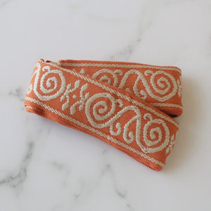 Apricot and tan embroidered tape trim