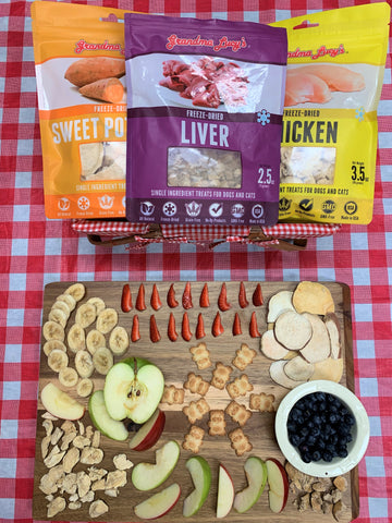 dog charcuterie board with treats and fruit