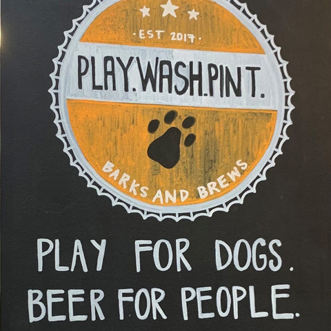"""brewery sign """"play for dogs. beer for people"""""""