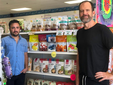 Dom (sales rep) and owner Chris stand in front of Grandma Lucy's treats