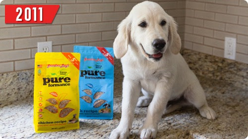 2011 - Puppy with two bags of Pureformance dog food