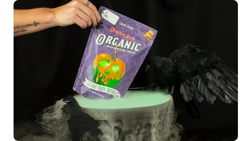 Limited edition Carmel Apple Treats being pulled from a spooky bowl of dry ice