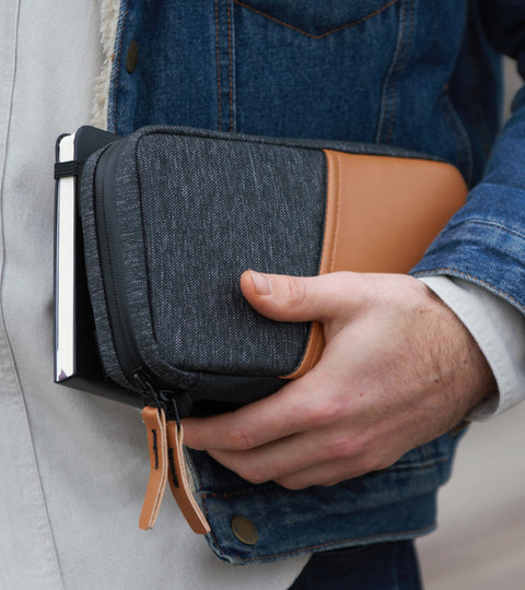 Man carrying Etchr Field Case and Sketchbook