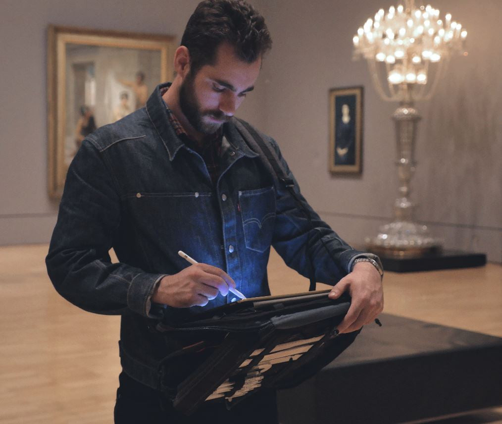 Man using Etchr Art Satchel in Supported Mode referencing work in an art gallery