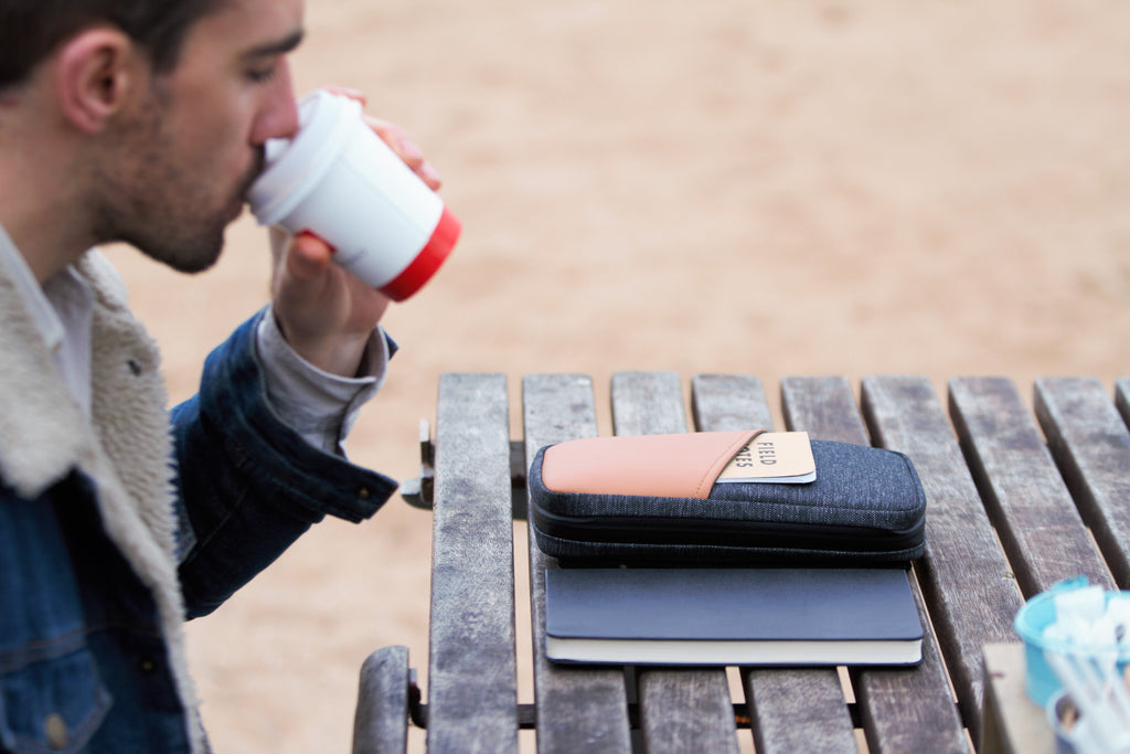 Man drinking coffee with Etchr Field Case
