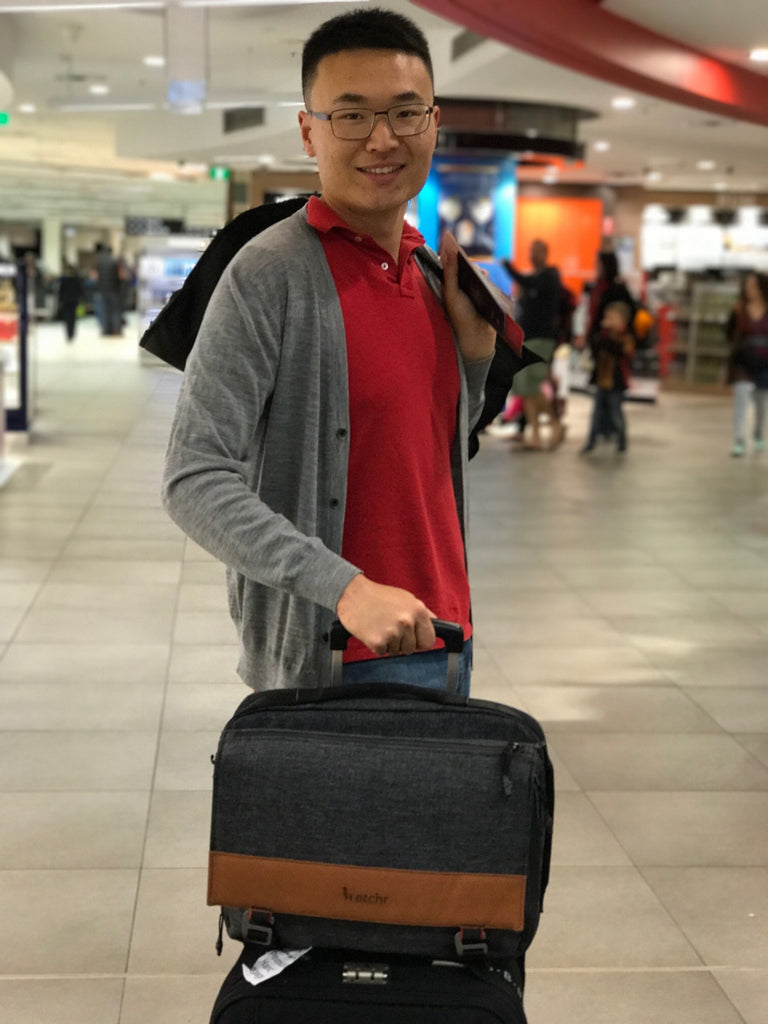 Yan in airport with Etchr Art Satchel
