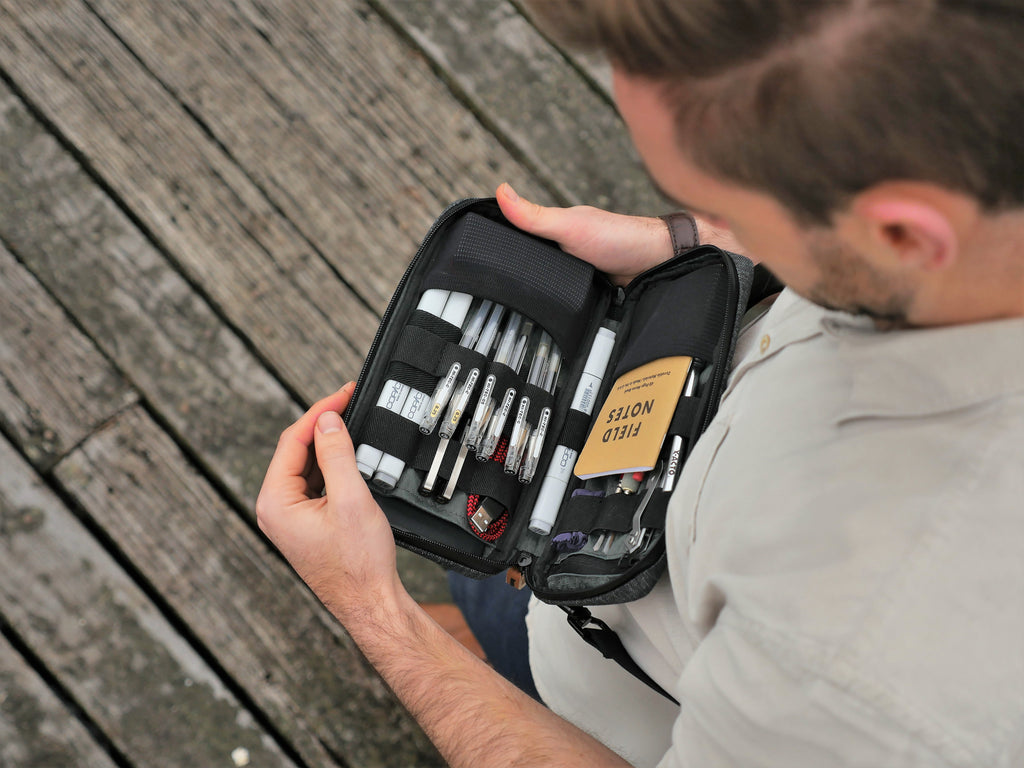 Man opening Etchr Field Case to access sketching tools
