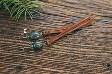 Chrysocolla and leather fringe earring shown on wood background. Pair E