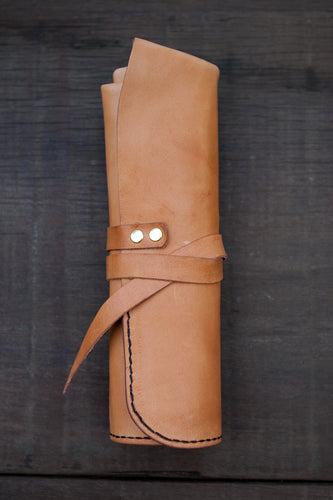 Artist's leather Tool Roll shown in oak