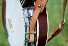 Leather adapter allows guitar straps to be used on banjos