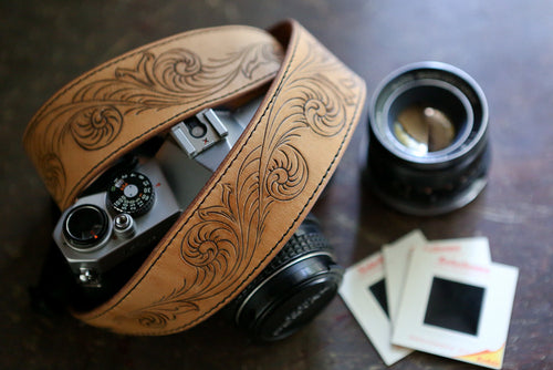 Hand carved leather camera strap with camera, lens and film slides