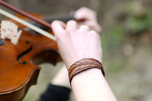 Violin player wearing the leather Feather Cuff Bracelet