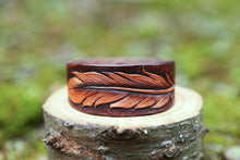 Leather cuff with hand carved feather design