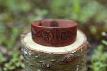 Leather cuff with hand carved scrollwork design