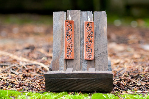 Rectangle shaped leather earrings with hand-carved scrollwork