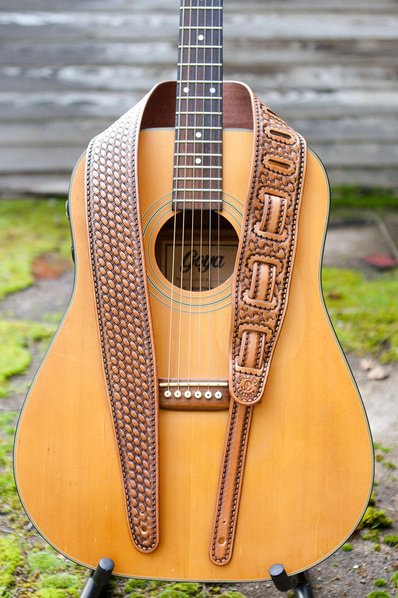 Basket stamped leather guitar strap shown on guitar