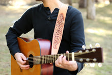 Guitar player models Engraver's Scroll leather strap