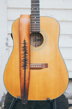 Hand carved lodgepole pine tree leather guitar strap  shown on guitar