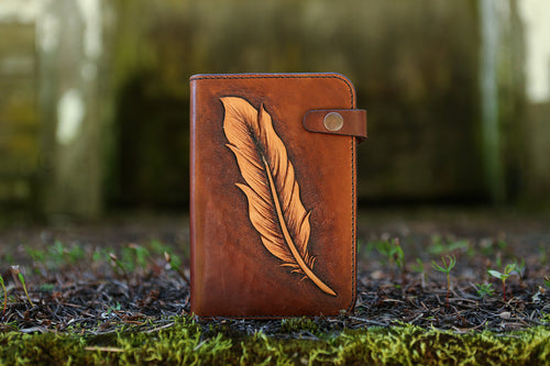 Handcrafted leather journal with hand carved feather design