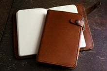 Handcrafted leather journals on desk