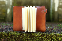 Sleeves inside the journal allow you to insert Moleskine notebook refills