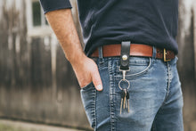 Man wearing black leather key fob on his belt
