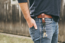 Man wearing mahogany leather HK clip key fob on his belt