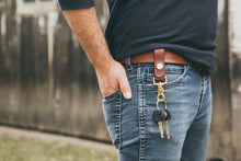 Man wearing mahogany leather key fob on his belt