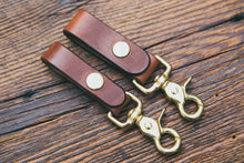 "Mahogany leather key fobs with solid brass trigger snap, shown in two widths: 3/4"" and 1"""