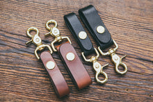 "Mahogany and black trigger snap key fobs shown in two widths: 3/4"" and 1"""