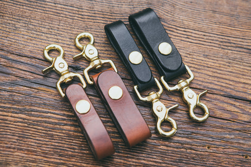 Mahogany and black trigger snap key fobs shown in two widths: 3/4