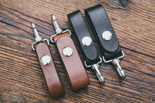 "Mahogany and black spring clip key fobs shown in two widths: 3/4"" and 1"""