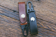 Handcrafted leather key fobs shown in Mahogany and Black