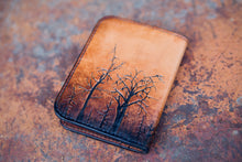 Back detail of  hand-tooled and dyed leather tree wallet