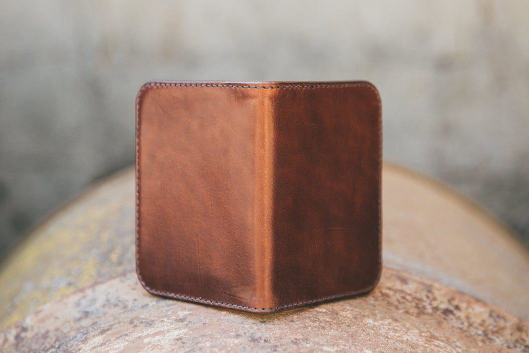 Tetra Four Pocket wallet handcrafted with USA harness leather in a rich brown