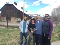 My family spending time by a barn in Beaver Creek, Colorado