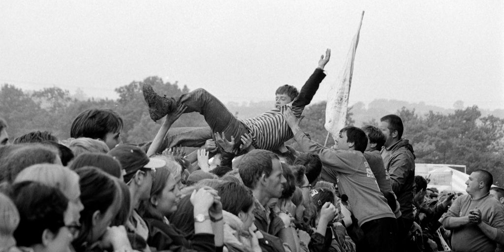 Crowd surfing at the Glastonbury Festival 1997