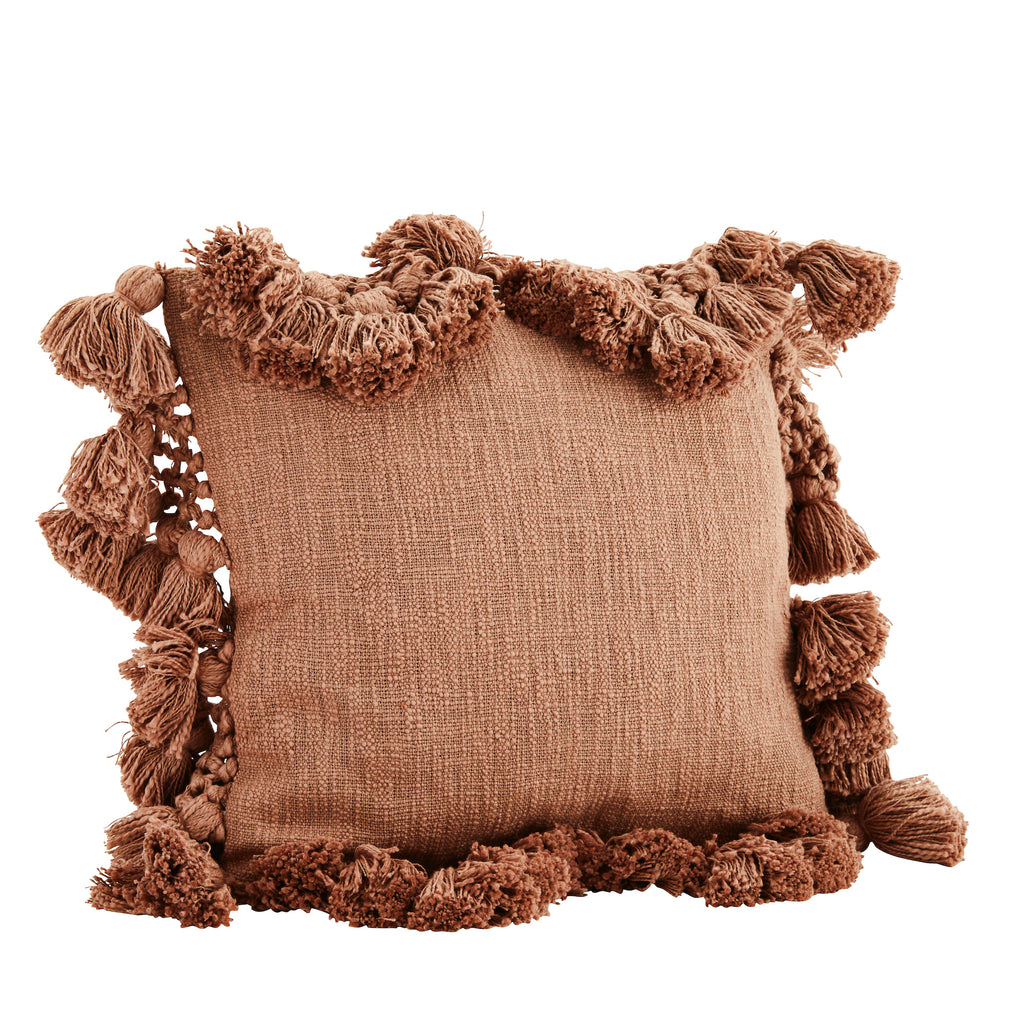 Square paprika cushion with tassels