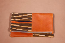 Orange leather foldover clutch bag featuring Baule cloth; handmade in Africa by Chameleon Goods