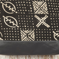 Close-up of the Black Leather Crossbody Bag with Mud cloth; handmade in Africa by Chameleon Goods