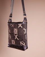 Black Leather Crossbody Bag with Mud cloth; handmade in Africa by Chameleon Goods