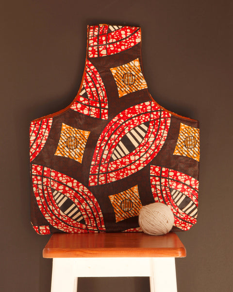 Large knitting bag for makers in a colorful brown waxed cotton print. Handmade in Africa by Chameleon Goods.