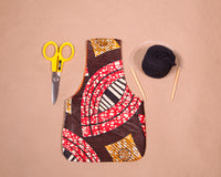 Small knitting bag for makers in brown waxed cotton print. Handmade in Africa by Chameleon Goods.