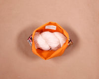 Our small knitting bags carry one skein of yarn for all your small projects. Handmade in Africa by Chameleon Goods.