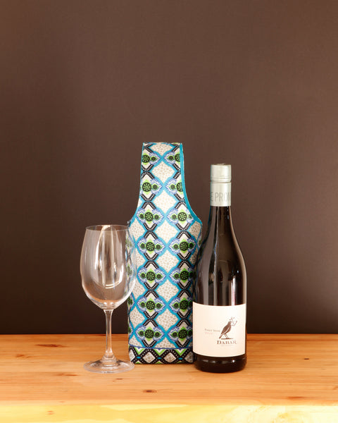 Sometimes wine is just necessary. And when it is, why not carry it in a pretty wine tote. Ours are lightly padded, fully lined, and handmade in Africa by Chameleon Goods.