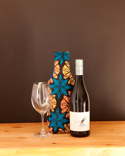 You can't buy happiness, but you can carry your wine in a pretty wine carrier, and that's kind of the same thing. Handmade in Africa by Chameleon Goods.